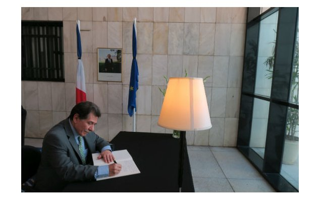 The Ambassador of Greece signing the condolence book at the French Embassy on 19 July 2016.