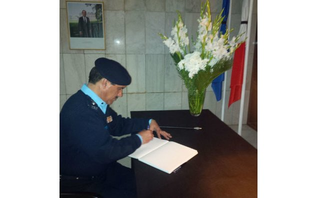 Mr. Jamil Hashmi, Superintendent Police of Security Division Islamabad, signing the condolence book at the French Embassy