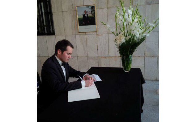 The Chargé d'Affaires of the Czech Republic in Pakistan signing the condolence book at the French Embassy