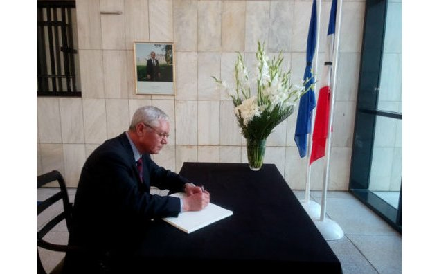 The Ambassador of Algeria to Pakistan signing the condolence book at the French Embassy.
