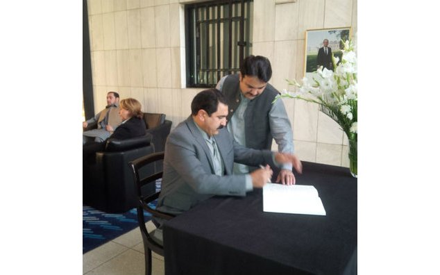 Mr. Sajid Hussain Turi, MNA Tribal Areas (FATA), signing the condolence book at the French Embassy
