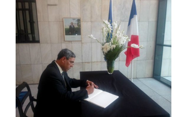 Mr. Syed Shahzad Hussain Naqvi, Central Deputy Chief Organizer of Pakistan Awami Tehrik, signing the condolence book at the French Embassy on 19 November 2015.