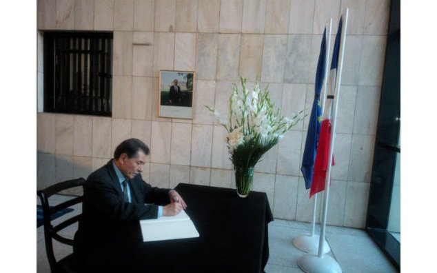 The Ambassador of Greece signing the condolence book at the French Embassy