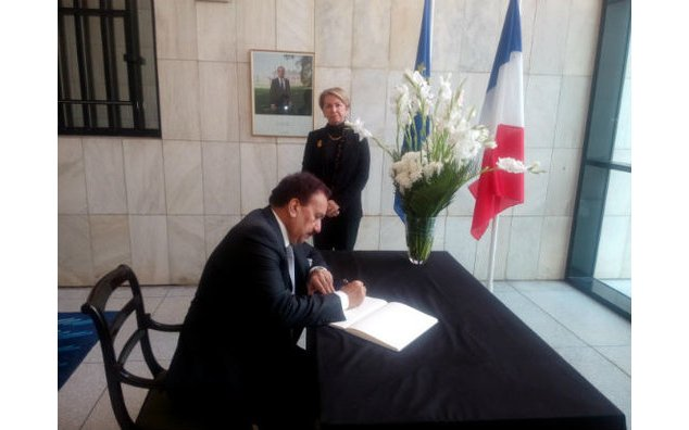 Senator Rehman Malik, former Interior Minister, signing the condolence book at the French Embassy