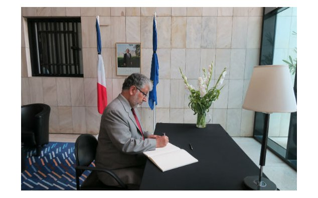 Dr. Mukhtar Ahmed, Chairman HEC, signing condolences book at the French Embassy, Islamabad on 21 July 2016.