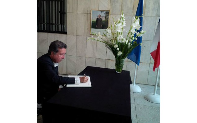 Senator Afrasiab Khattak of Awami National Party sign the condolence book at the French Embassy