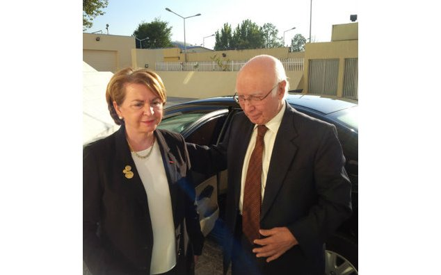 Mrs. Martine Dorance, Ambassador of France to Pakistan, welcoming Mr. Sartaj Aziz, Advisor to the Prime Minister for Foreign Affairs.