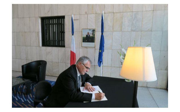 The Ambassador of Hungary signing condolences book at the French Embassy Islamabad on 19 July 2016.