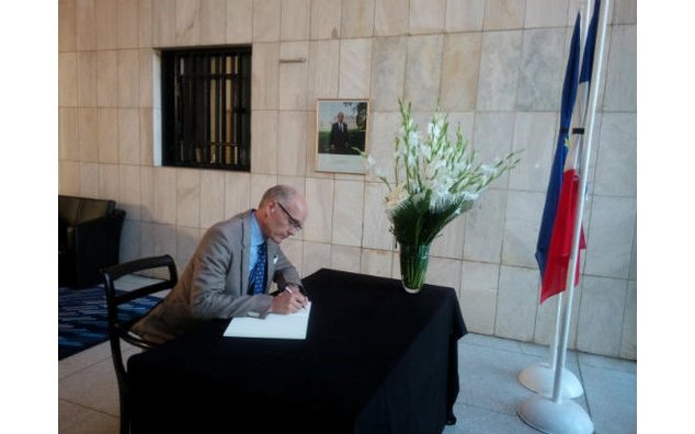The ambassador of Sweden signing the condolence book at the French Embassy