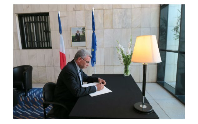 The Chargé d'Affaires of Iran signing condolence Book at the French Embassy Islamabad on 19 July 2016.