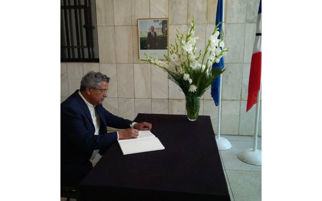 Mr. Syed Mehmood Nasir, Inspector General Forests, signing the condolence book at the French Embassy