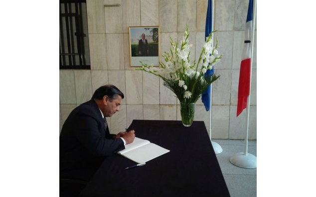 The Ambassador of India to Pakistan sign the condolence book at the French Embassy