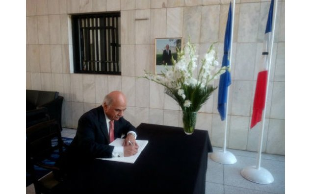 Mr. Mohamed Jahangzeb Khan, Secretary Energy, Punjab, signing the condolence book at the French Embassy