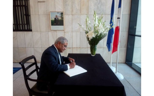 Mr. Aziz Bolani, CEO of Serena Hotels, sign the condolence book at the French Embassy
