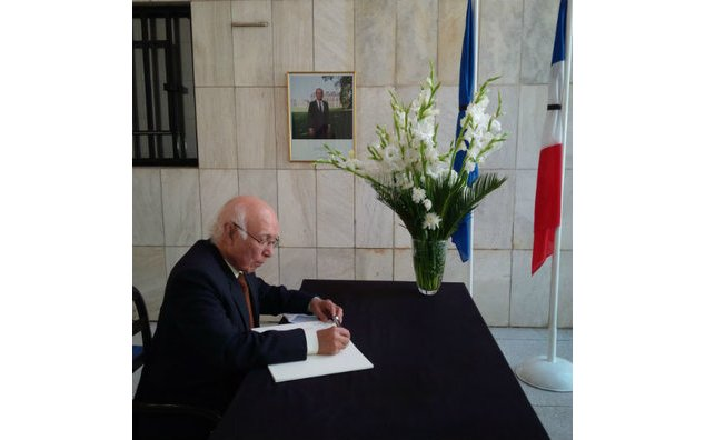 Mr. Sartaj Aziz, Advisor to the Prime Minister for Foreign Affairs, signing the condolence book at the French Embassy