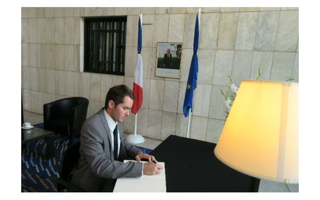 The Chargé d'Affaires of the Czech Republic signing the condolence book at the French Embassy on 19 July 2016.