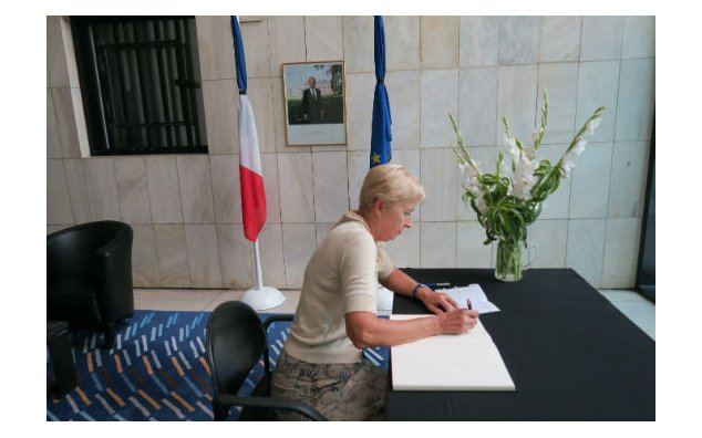 The Ambassador of Austria signing the condolence book at the French Embassy on 20 July 2016.