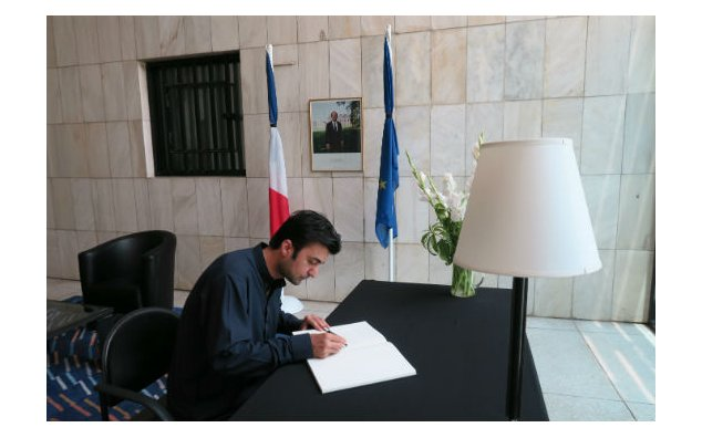 MNA, Mr. Murad Saeed, signing condolence book at the French Embassy, Islamabad on 21 July 2016.