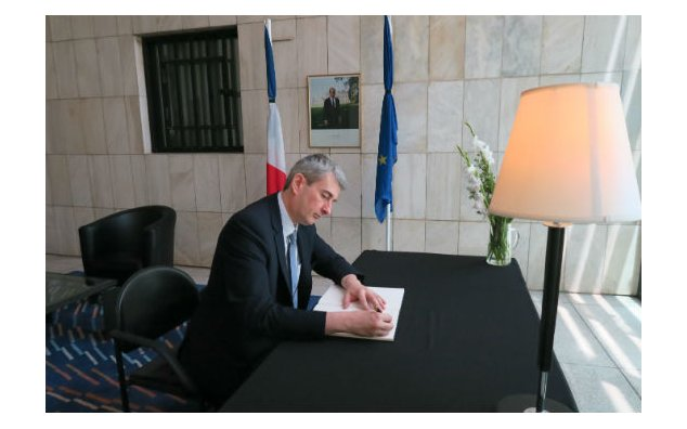 The Ambassador of Belgium signing the condolences book at the French Embassy Islamabad on 19 July 2016.