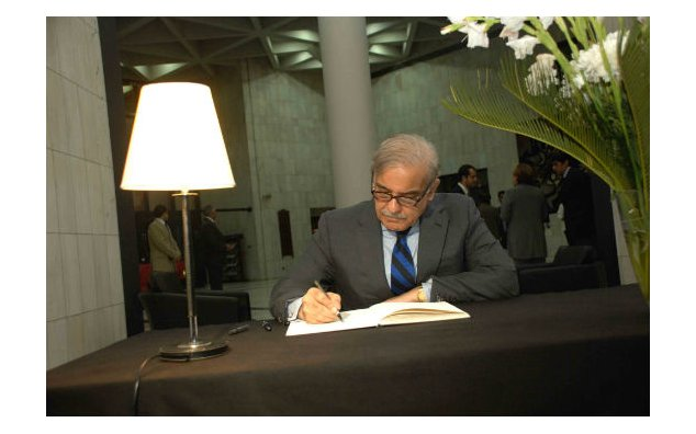 Mr. Muhammad Shahbaz Sharif, Chief Minister of Punjab, signing the condolence book at the French Embassy on 20 November 2015