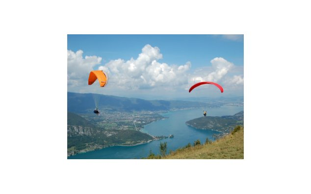 Paragliders over the Lake of Annecy