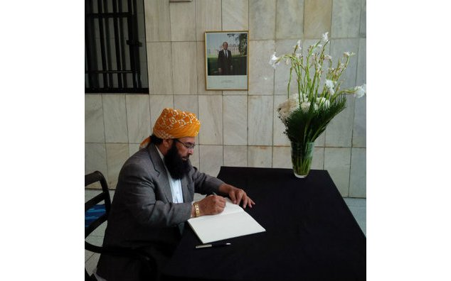 Maulana Abdul Ghafoor Haideri, Deputy Chairman Senate, and Vice-President of Jamiat Ulema-e-Islam-F, signing the condolence book at the French Embassy