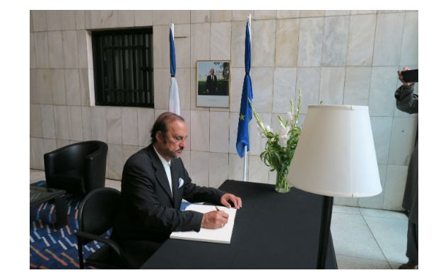 Senator Zaheer-ud-Din Babar Awan, signing condolence book at the French Embassy, Islamabad on 20 July 2016