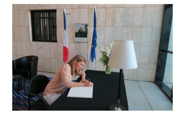 Mrs. Amélie Herenstein, Bureau Chief AFP, signing condolences book at the French Embassy Islamabad on 20 July 2016.
