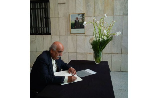 Mr. Syed Khursheed Ahmad Shah, MNA PPP and leader of the Opposition at the National Assembly, sign the condolence book at the French Embassy