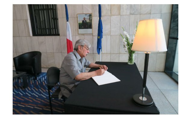 Senator Ilyas Ahmad Bilour, signing condolence book at the French Embassy, Islamabad on 19 July 2016.