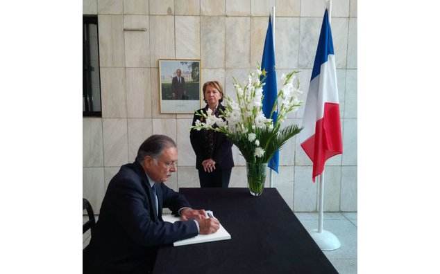 Mr. Pervaiz Rashid, Minister for Information, Broadcasting and National Heritage and Law, Justice and Human Rights signing the condolence book at the French Embassy